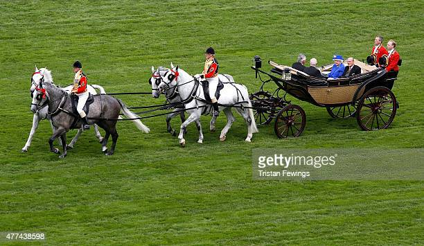 Queen Elizabeth II and Prince Phillip the Duke of Edinburgh during the Royal Procession on Day 2 of Royal Ascot 2015 at Ascot racecourse on June 17...