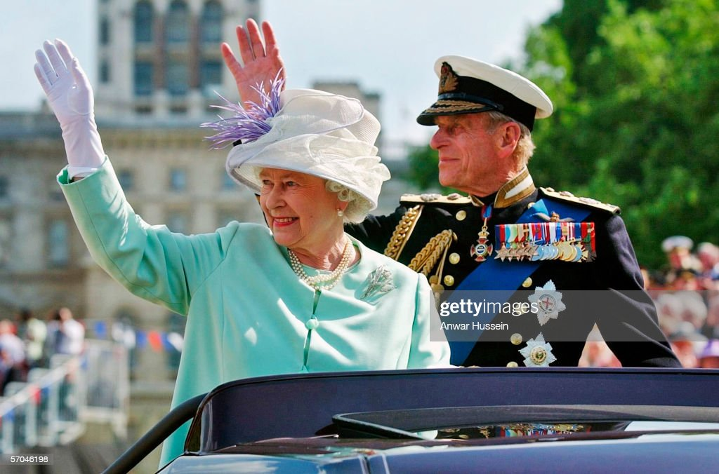 Queen Elizabeth II and Prince Phillip the Duke of Edinburgh wave to the crowd as they leave the 'Recollections Of World War II Commemoration Show', an hour long show performed for thousands of World War II veterans marking the end of the World War II 60 years ago, at Horse Guards Parade on National Commemoration Day July 10, 2005 in London. The show included two minutes' silence in remembrance of the fallen, and the Royal Air Force Missing Man formation flew over Horse Guards Parade.