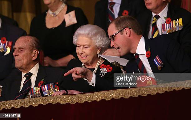 Queen Elizabeth II and Prince William Duke of Cambridge chat to each other as Prince Philip Duke of Edinburgh looks on in the Royal Box at the Royal...