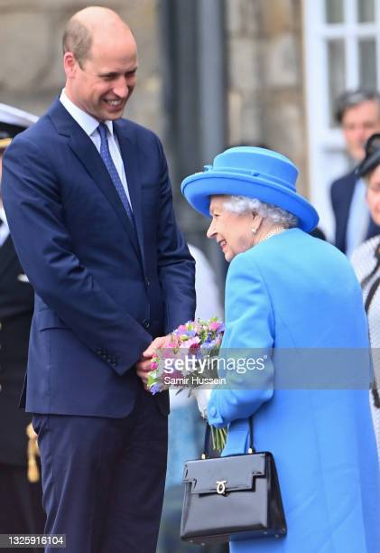 Queen Elizabeth II and Prince William, Duke of Cambridge smile as they attend the Ceremony of the Keys at the Palace of Holyroodhouse on June 28,...
