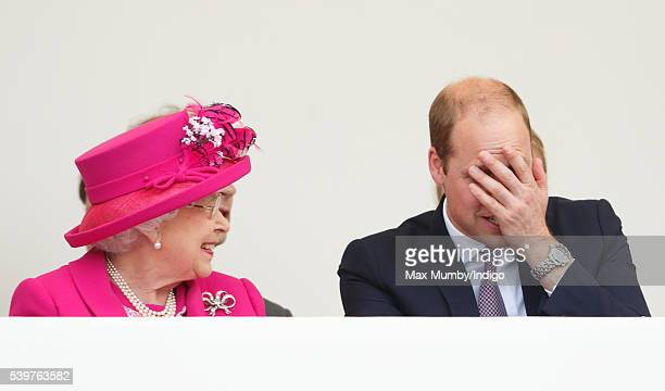 Queen Elizabeth II and Prince William Duke of Cambridge watch a carnival parade as they attend 'The Patron's Lunch' celebrations to mark Queen...