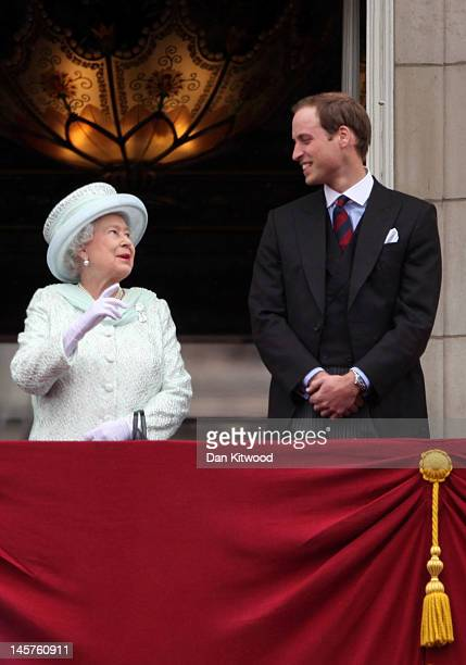 Queen Elizabeth II and Prince William, Duke of Cambridge wave to the crowds from Buckingham Palace during the Diamond Jubilee carriage procession...