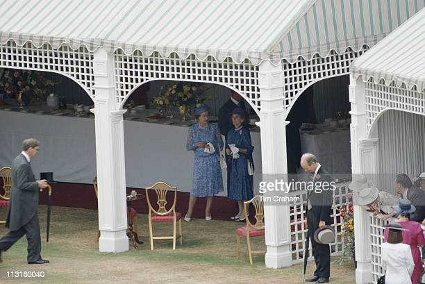 Queen Elizabeth II and Princess Alice, Duchess of Gloucester standing in the diplomatic tent at a garden party at Buckingham Palace, London, England,...