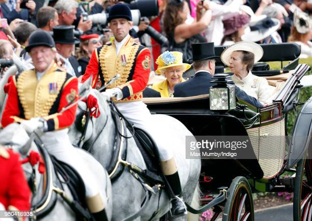 Queen Elizabeth II and Princess Anne Princess Royal arrive by horse drawn carriage on day 1 of Royal Ascot at Ascot Racecourse on June 19 2018 in...