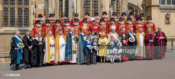 Queen Elizabeth II and Princess Eugenie of York hold nosegays as they attend the traditional Royal Maundy Service at St George's Chapel on April 18...