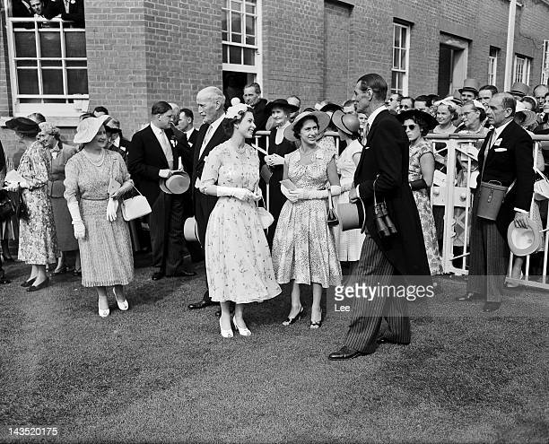 Queen Elizabeth II and Princess Margaret greet trainer Noel Murless in the unsaddling enclosure at Ascot after the Queen's horse Jardiniere won the...