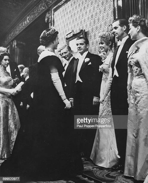 Queen Elizabeth II and Princess Margaret meet with the stars of the film 'The Battle of the River Plate' following the Royal Film Performance...