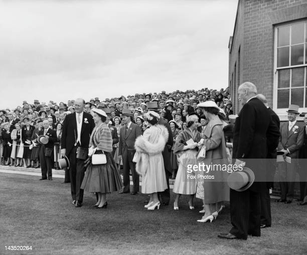 Queen Elizabeth II and Princess Margaret with racehorse trainer Sir Cecil Boyd-Rochfort during the Royal Hunt Cup at Ascot, 20th June 1956. Also...
