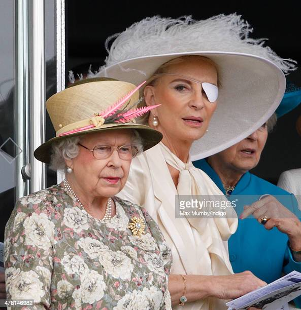 Queen Elizabeth II and Princess Michael of Kent watch the racing from the balcony of the Royal Box as they attend Derby Day during the Investec Derby...