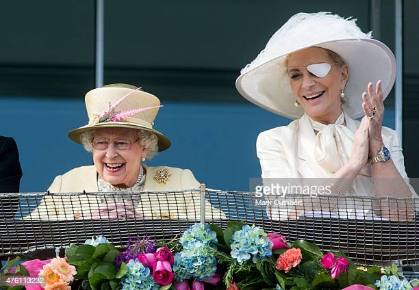 Queen Elizabeth II and Princess Michael of Kent watching the racing on Derby Day at Epsom Racecourse on June 6 2015 in Epsom England