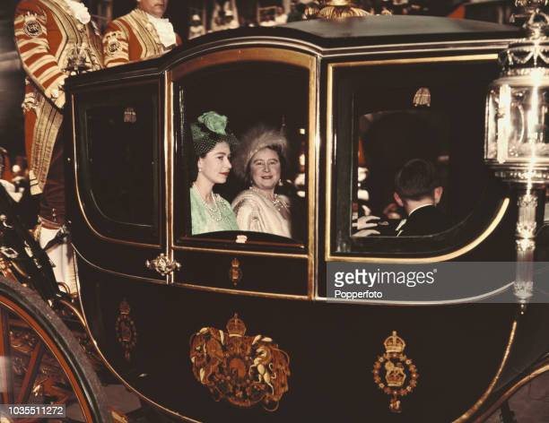 Queen Elizabeth II and Queen Elizabeth The Queen Mother pictured with Prince Charles riding in Queen Alexandra's state coach on the day of the royal...