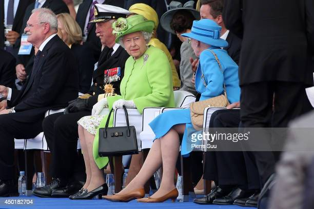 Queen Elizabeth II and Queen Margrethe II of Denmark attend the international ceremony on June 6, 2014 in Ouistreham, France.