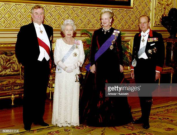 Queen Elizabeth II and Queen Margrethe of Denmark with Prince Philip Duke of Edinburgh and Prince Henrik pose before the state banquet at St George's...