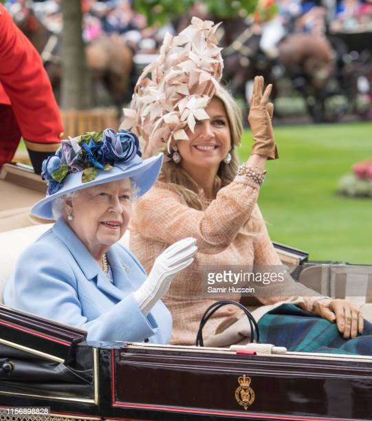 Queen Elizabeth II and Queen Maxima of the Netherlands arrive by carriage on day one of Royal Ascot at Ascot Racecourse on June 18, 2019 in Ascot,...