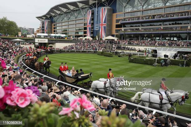 Queen Elizabeth II and Queen Maxima of the Netherlands arrive for the first day of races at Ascot Racecourse on June 18, 2019 in Ascot, England. The...