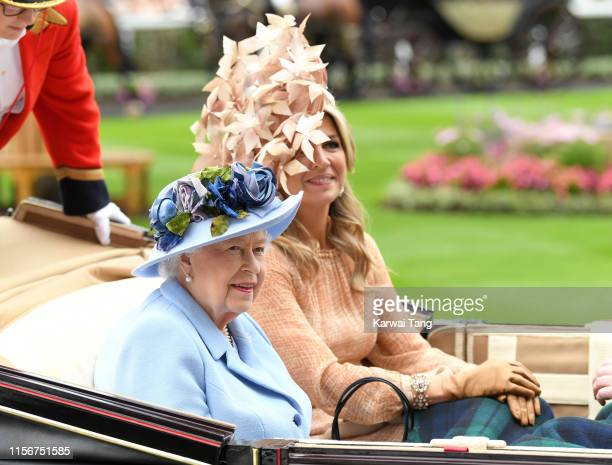 Queen Elizabeth II and Queen Maxima of the Netherlands attend day one of Royal Ascot at Ascot Racecourse on June 18, 2019 in Ascot, England.