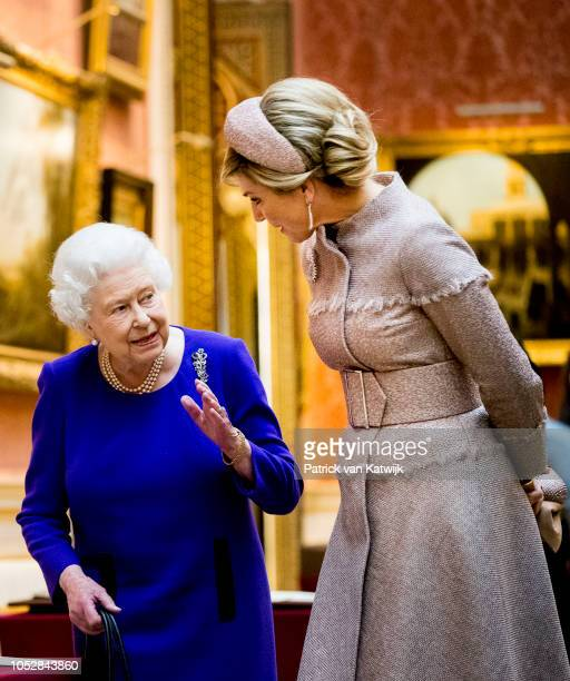 Queen Elizabeth II and Queen Maxima of The Netherlands visit the Picture Gallery in Buckingham Palace on October 23 2018 in London United Kingdom...