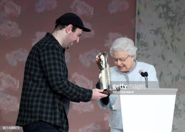 Queen Elizabeth II and Richard Quinn attend the Richard Quinn show during London Fashion Week February 2018 at BFC Show Space on February 20, 2018 in...
