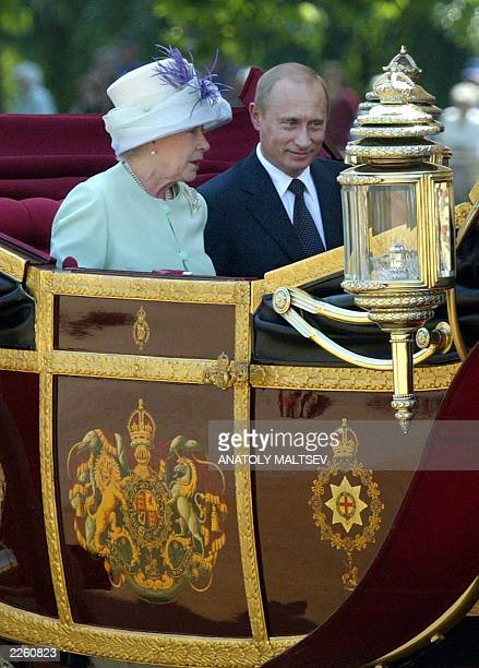 Queen Elizabeth II and Russian President Vladimir Putin arrive at Horse Guards Parade, London, 24 June on the first day of his state visit. It is the...