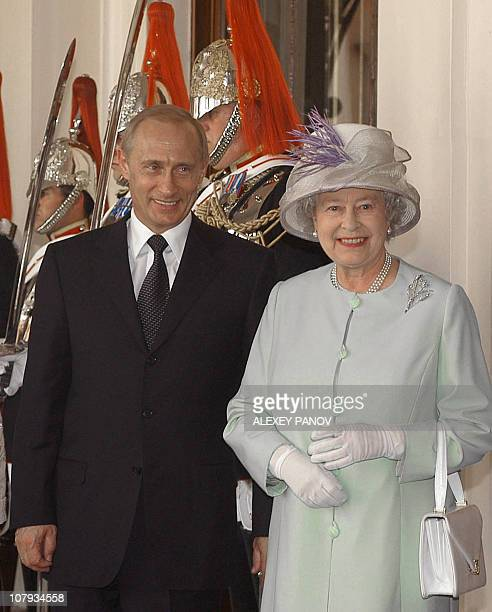 Queen Elizabeth II and Russia's President Vladimir Putin pose after the official welcome ceremony at Horse Guards in London 24 June 2003 Putin...