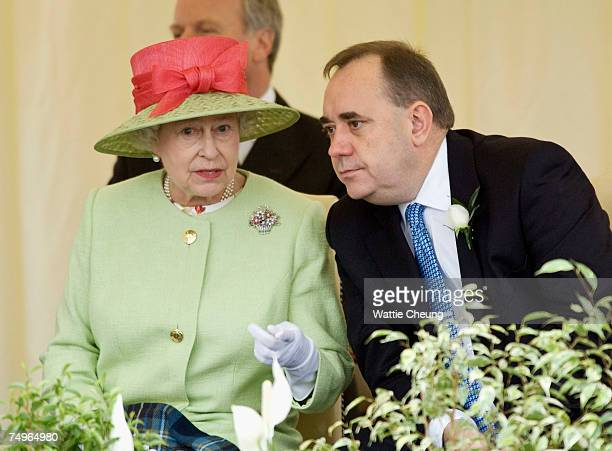 Queen Elizabeth II and Scotland's First Minister Alex Salmond watch the Riding procession go past at the opening of the third session of the Scottish...
