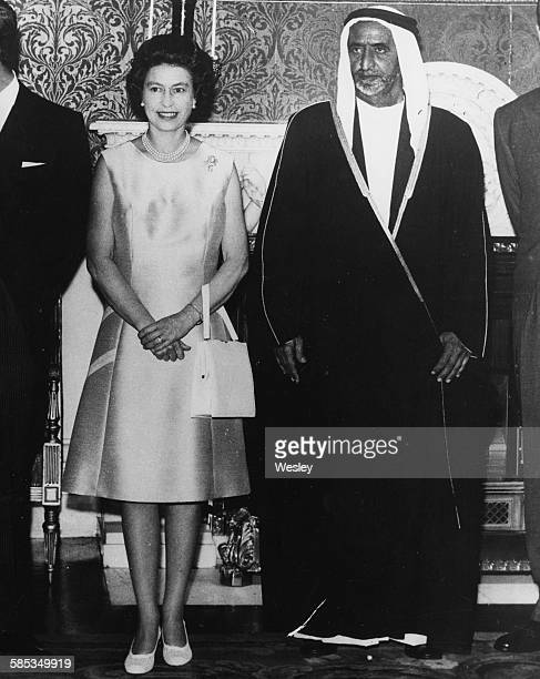 Queen Elizabeth II and Sheikh Rashid Saeed Al Maktoum Ruler of Dubai attending a luncheon at Buckingham Palace London July 22nd 1969