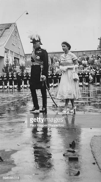 Queen Elizabeth II and Sir Willoughby Norrie , Governor General, arrive at Auckland Dockyard during the Royal Tour of New Zealand, March 12th 1954.