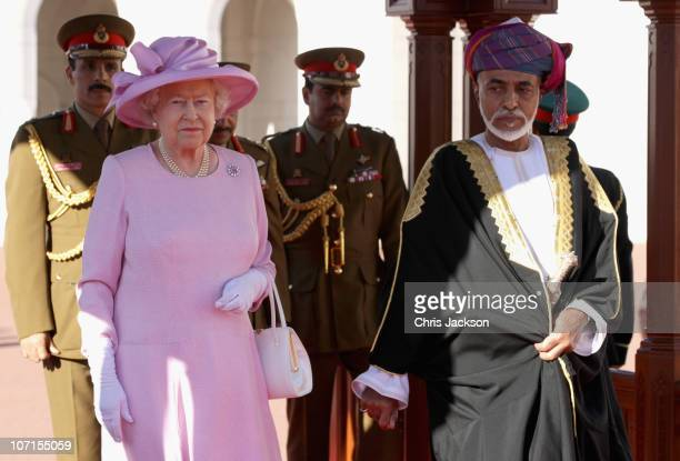 Queen Elizabeth II and Sultan Qaboos bin Said take the salute at Al-Alam Palace on November 26, 2010 in Muscat, Oman. Queen Elizabeth II and Prince...