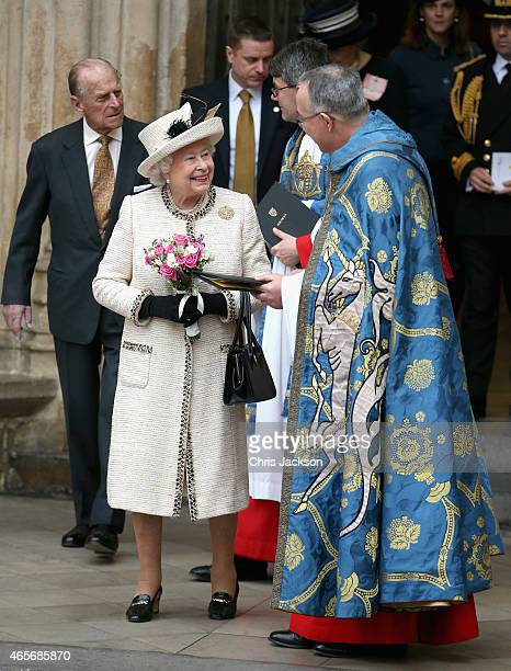 Queen Elizabeth II and the Dean of Westminster Reverend John Hall attend the Observance for Commonwealth Day Service At Westminster Abbey on March 9...
