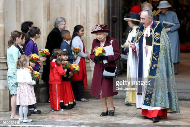 Queen Elizabeth II and the Dean of Westminster the Very Reverend John Hall depart from the 2018 Commonwealth Day service at Westminster Abbey on...