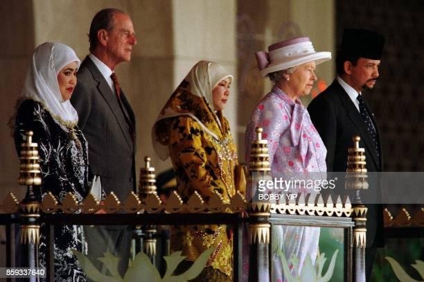 Queen Elizabeth II and the Duke of Edinburgh accompanied by Brunei Sultan Hassanal Bolkiah Queen Raja Isteri Pengiran Anak Hajah Saleha and Royal...