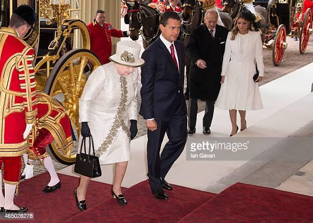 Queen Elizabeth II and the Duke of Edinburgh accompany the President of the United Mexican States, Senor Enrique Pena Nieto and Senora Angelica...