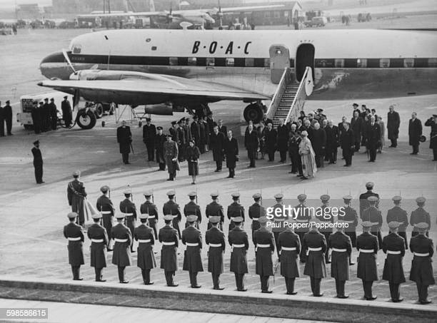 Queen Elizabeth II and the Duke of Edinburgh are greeted by an RAF Guard of Honour and a group of politicians including Prime Minister Sir Anthony...