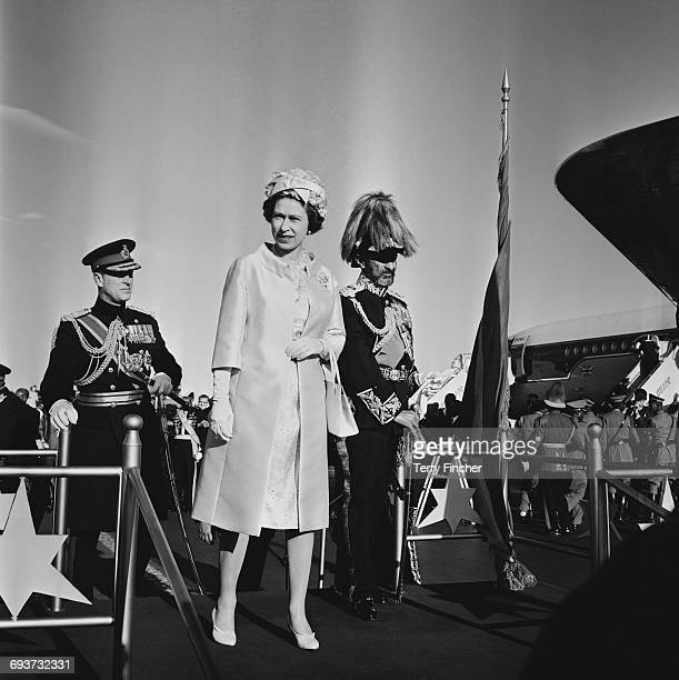 Queen Elizabeth II and the Duke of Edinburgh are greeted by Haile Selassie upon their arrival in Addis Ababa Ethiopia February 1965
