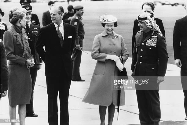Queen Elizabeth II and the Duke of Edinburgh are greeted by King Hussein of Jordan and Queen Noor of Jordan upon their arrival in Amman Jordan 26th...