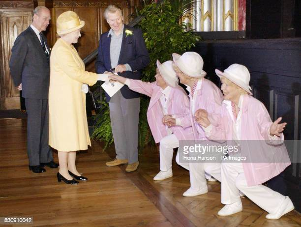 Queen Elizabeth II and the Duke of Edinburgh are greeted by Max Bygraves and the Beverley Sisters at the Broadway Theatre in Catford southeast London...