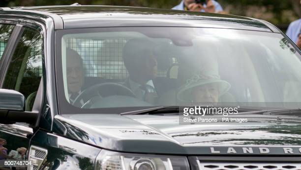 Queen Elizabeth II and the Duke of Edinburgh arrive for the Bentley Motors Royal Windsor Cup Final at Guards Polo Club Windsor Great Park Egham...