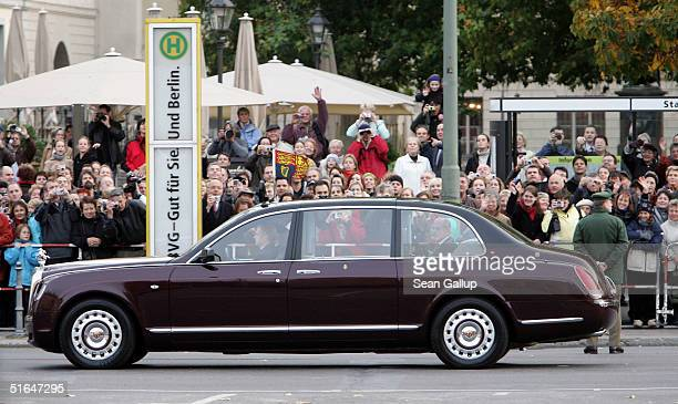 Queen Elizabeth II and the Duke of Edinburgh arrive in the Royal Bentley at the Neue Wache war memorial where she laid a wreath on the first day of...
