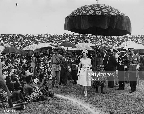 Queen Elizabeth II and the Duke of Edinburgh at Kumasi Sports Stadium in Kumasi, during their Commonwealth Visit to Ghana, 16th November 1961. They...