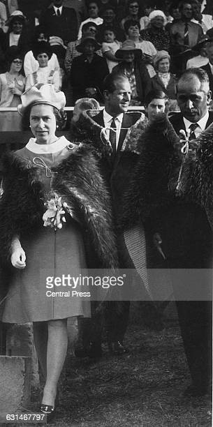 Queen Elizabeth II and the Duke of Edinburgh attend an exhibition of Maori culture at Rugby Park in Gisborne during their tour of New Zealand 22nd...