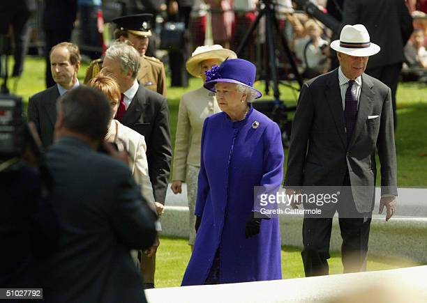 Queen Elizabeth II and the Duke of Edinburgh attend the opening of the Diana Memorial Fountain in memory of the late Princess Diana at the south side...