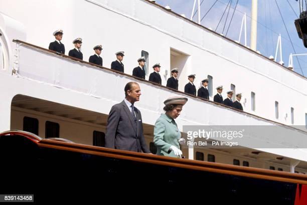 Queen Elizabeth II and the Duke of Edinburgh disembarking from the Royal Yacht Britannia in Portsmouth Dockyard