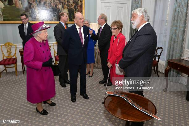 Queen Elizabeth II and the Duke of Edinburgh during a private audience and presentation of a boomerang by some indigenous people
