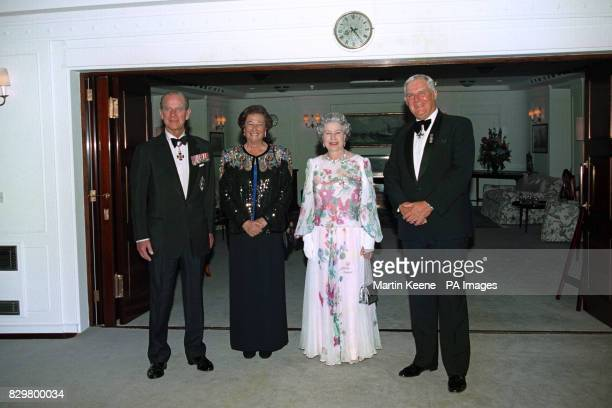 Queen Elizabeth II and the Duke of Edinburgh entertaining Cayman Islands Governor Michael Gore and wife aboard the Royal Yacht Britannia