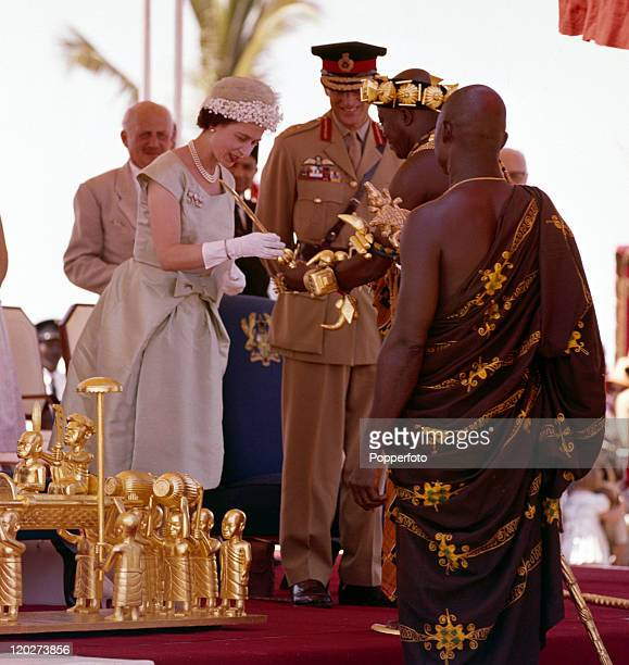 Queen Elizabeth II and the Duke of Edinburgh exchanging gifts with Ashanti chiefs during the Royal Tour of West Africa in Accra, Ghana, circa...