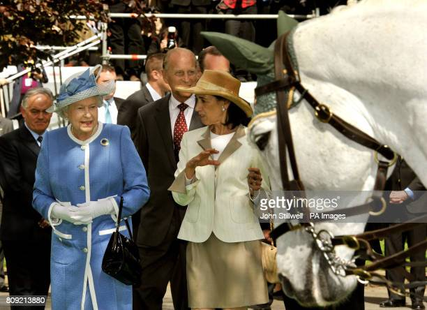 Queen Elizabeth II and the Duke of Edinburgh follow Lady Chryss O'Reilly during a visit to the Irish National Stud one of Ireland's top horsebreeding...