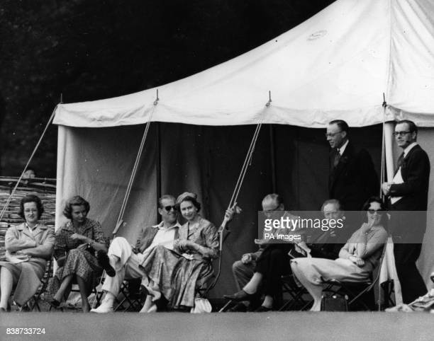 Queen Elizabeth II and the Duke of Edinburgh in Highclere Park Hampshire where the Duke waited to bat for his team The event was in aid of the...