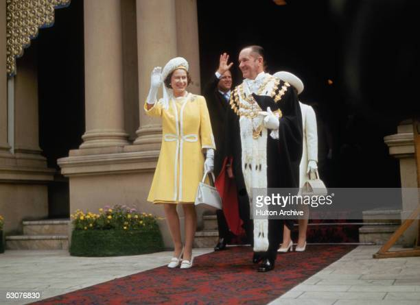 Queen Elizabeth II and the Duke of Edinburgh in Sydney with Emmet McDermott Lord Mayor of Sydney during their tour of Australia May 1970 They are...