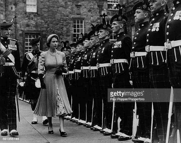 Queen Elizabeth II and the Duke of Edinburgh inspect the Guard of Honour of the 1st Battalion, King's Own Scottish Borderers, in Crown Square, during...