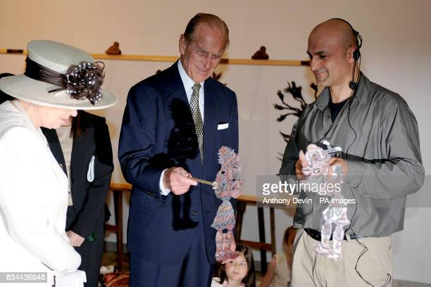 Queen Elizabeth II and the Duke of Edinburgh look at puppets during the second day of Their Royal Highnesses visit to the Republic of Turkey